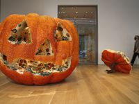 Artist Kathleen Ryan's, 'Jackie,' 2021, is on display at the Nasher Sculpture Center. It is an oversized pumpkin that is encrusted with semiprecious stones that convincingly simulate spreading mold.