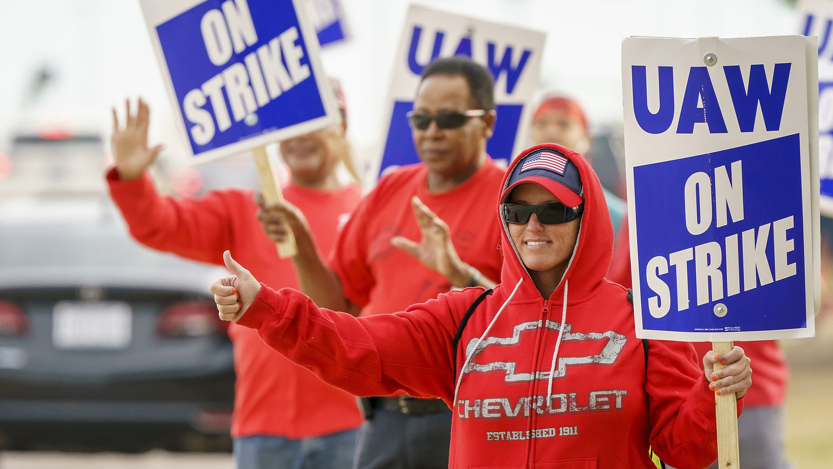 Jessica Hight joins fellow striking General Motors workers as they picket outside the GM Assembly Plant on Wednesday, Oct. 16, 2019, in Arlington.
