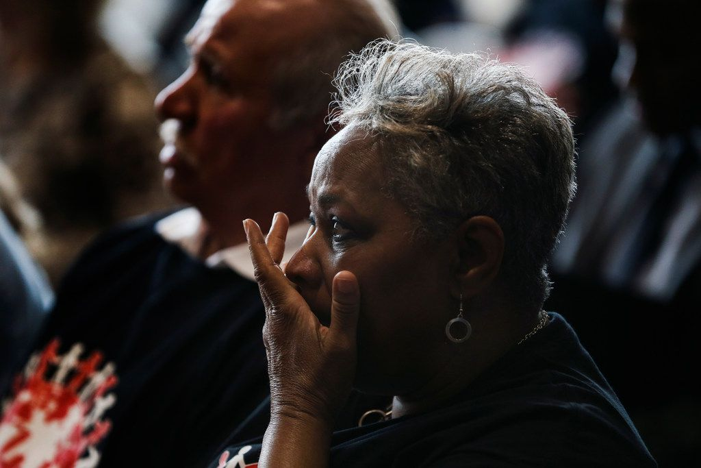 Marsha Jackson wipes a tear from her after as she listens to speakers during a press conference concerning Shingle Mountain at Dallas City Hall last March.