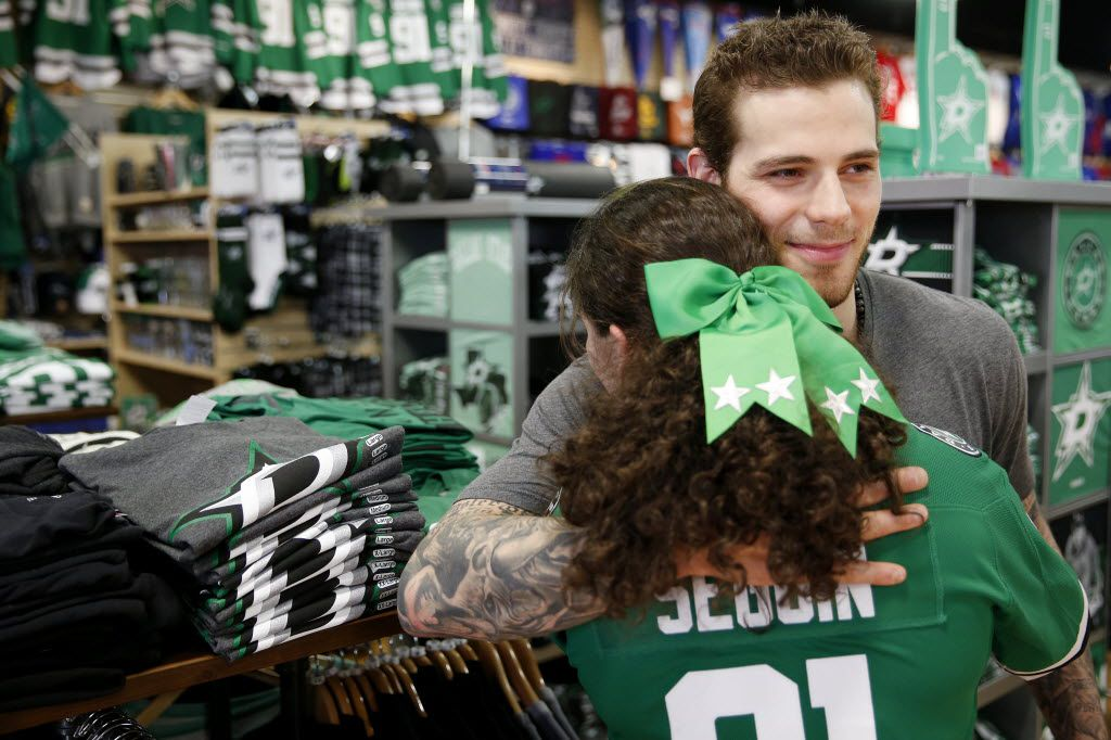 Nicole Berinshteyn, 13, of Plano, Texas, hugs Dallas Stars center Tyler Seguin while Seguin meets fans at Rally House in Dallas Monday March 14, 2016. (Andy Jacobsohn/The Dallas Morning News)