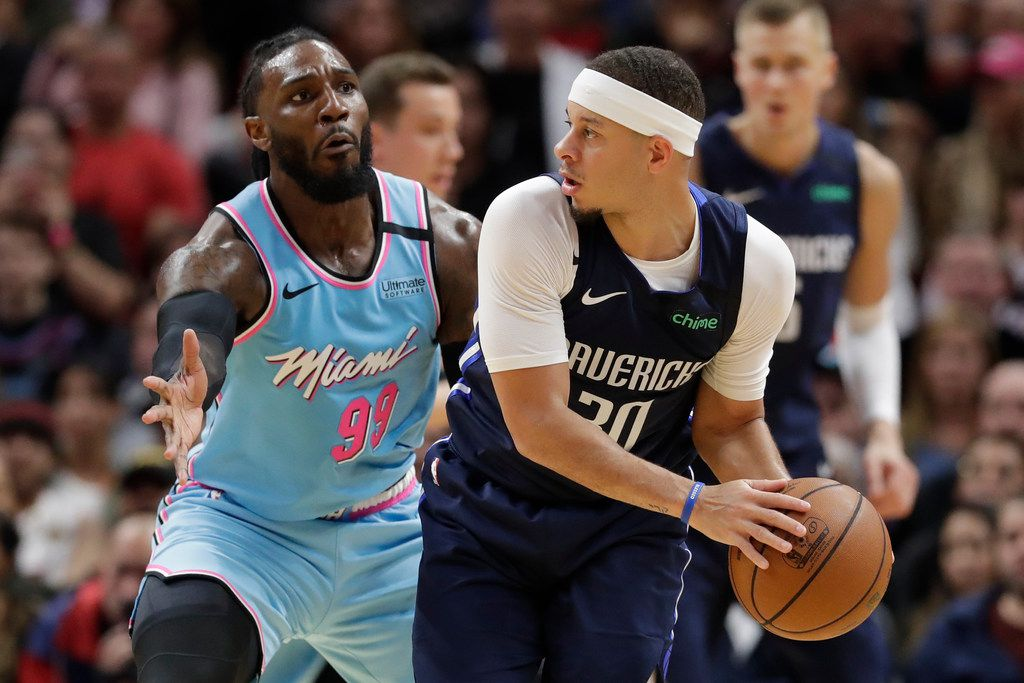 Dallas Mavericks guard Seth Curry (30) looks for an open teammate past Miami Heat forward Jae Crowder (99) during the second half of an NBA basketball game, Friday, Feb. 28, 2020, in Miami.