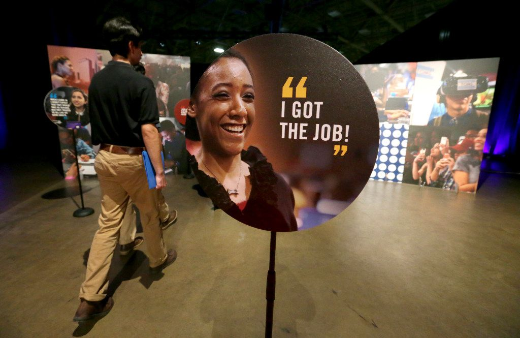 Job seekers met with company representatives on Friday at the 100,000 Opportunities job fair in Dallas.