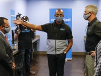 Hardmon Williams, vice president for AT&T Believes and community engagement (center), gives a tour of the Connected Learning Center to Dallas City Council member Jesse Moreno (left) and AT&T Communications CEO Jeff McElfresh at Family Gateway on Thursday, Sept. 16, 2021, in Dallas.