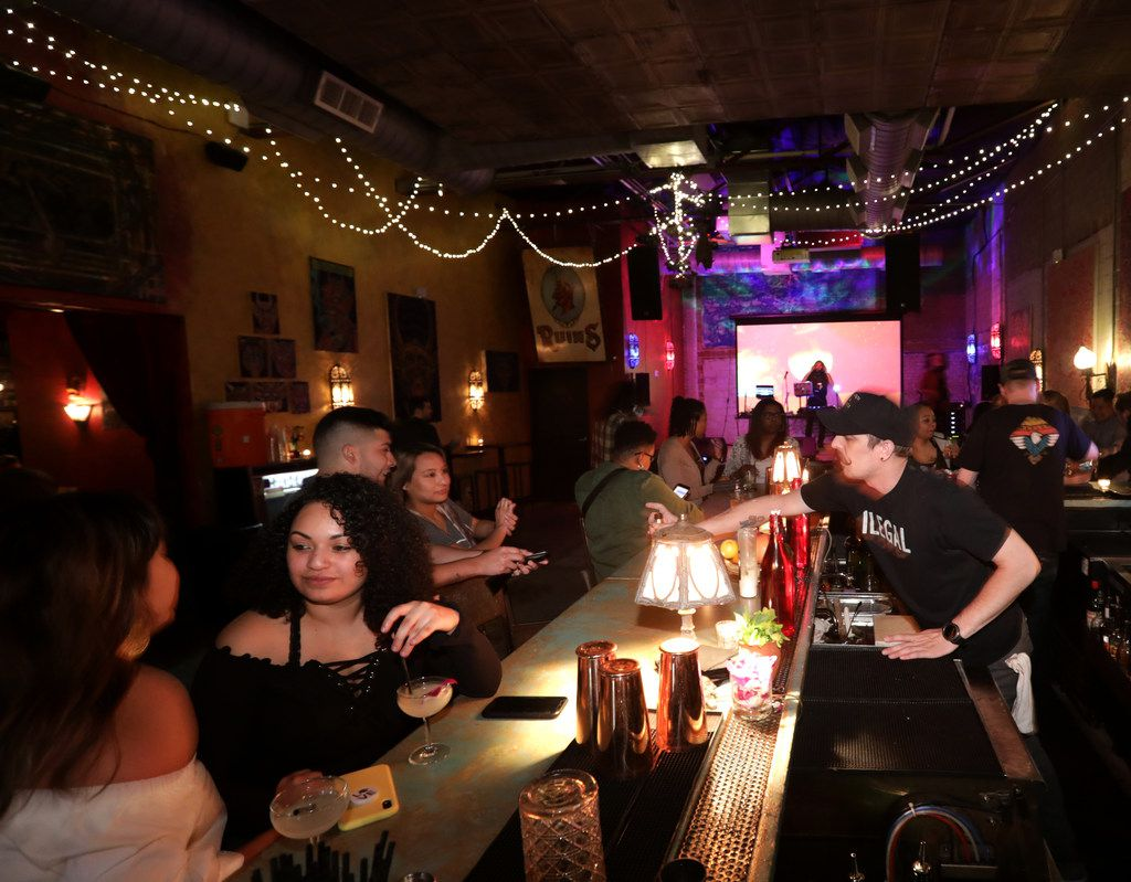 Guests enjoy the drinks, music, and atmosphere at Ruins in Dallas, TX, on Apr. 26, 2019. (Jason Janik/Special Contributor)