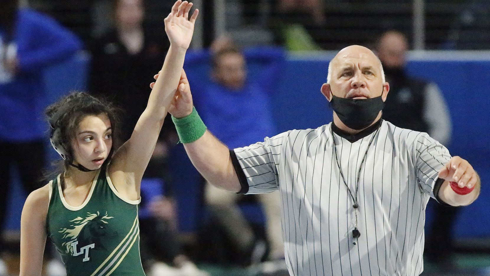 Janaya Baeza (left) of Lebanon Trail High School is declared the winner of her match during the UIL Region II wrestling meet held at Rockhill High School in Frisco on Saturday, April 17, 2021.