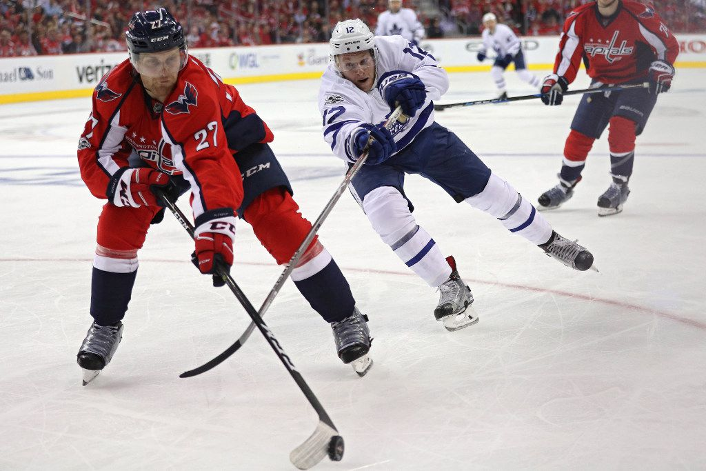 WASHINGTON, DC - APRIL 13: Karl Alzner #27 of the Washington Capitals and Connor Brown #12 of the Toronto Maple Leafs battle for the puck in the third period in Game One of the Eastern Conference First Round during the 2017 NHL Stanley Cup Playoffs at Verizon Center on April 13, 2017 in Washington, DC. (Photo by Patrick Smith/Getty Images)