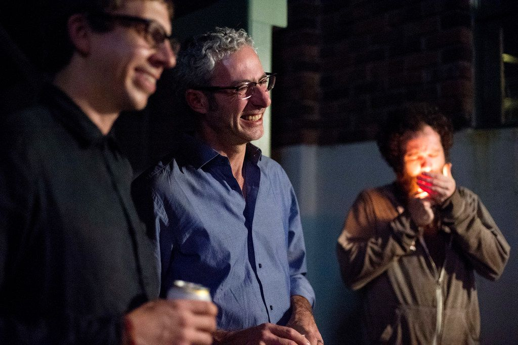 Mexico-based artist Carlos Ranc (center) chats with Gregory Ruppe (left) and Jeff Gibbons, founders of Culture Hole