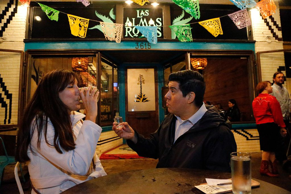 Dallas residents Rosa Guerrero  and Mark Benavidez try the brisket mezcal created in collaboration with Oaxaca based producer Gracias a Dios and offered at Las Almas Rotas in Dallas on Saturday night, February 2, 2019.