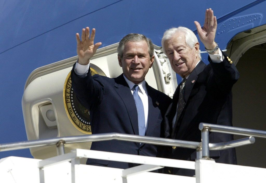 President George W. Bush and then-Rep. Ralph Hall waved as they arrive on Air Force One at Love Field in Dallas on March 8, 2004. Hall died on Thursday at age 95.