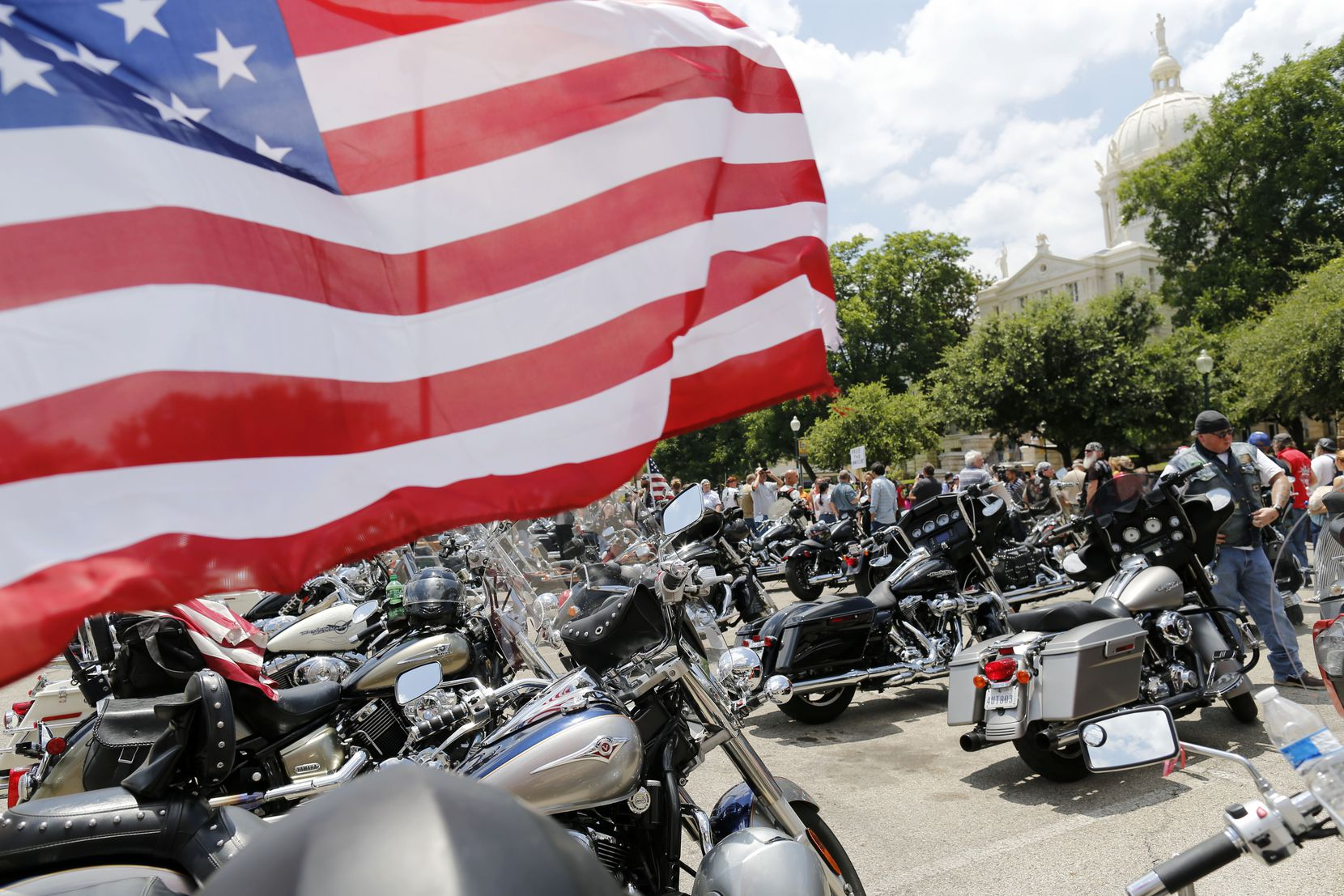 Bikes lined up in the parking lot during a motorcycle rally near McLennan County Courthouse in Waco, on Sunday, June 7, 2015. The bikers peacefully protested the recent action of local, state and federal law enforcement and administrative officials. (Vernon Bryant/The Dallas Morning News)