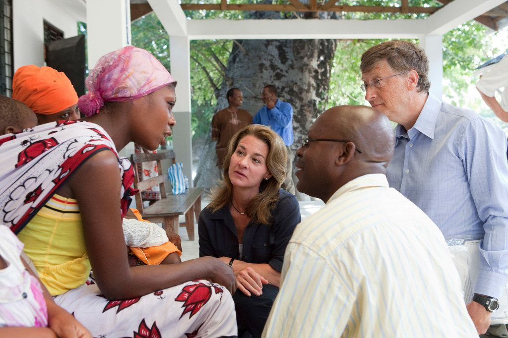 Bill and Melinda Gates speak with parents whose children are participating in the RTS,S malaria vaccine trial at the Bagamoyo District Hospital in Tanzania in 2011.