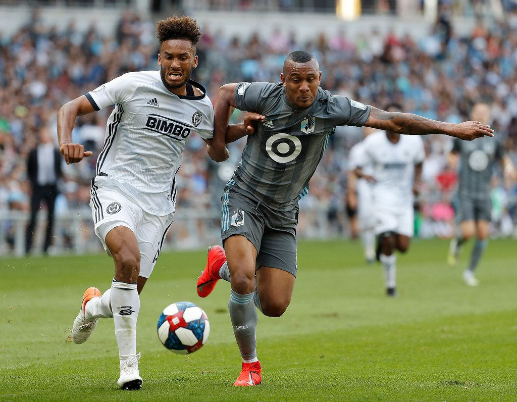 Philadelphia Union defender Auston Trusty, left, and Minnesota United forward Angelo Rodriguez  battle for the ball during the second half of an MLS soccer match, Sunday June, 2, 2019 in St. Paul, Minn. (Leila Navidi/Star Tribune via AP)