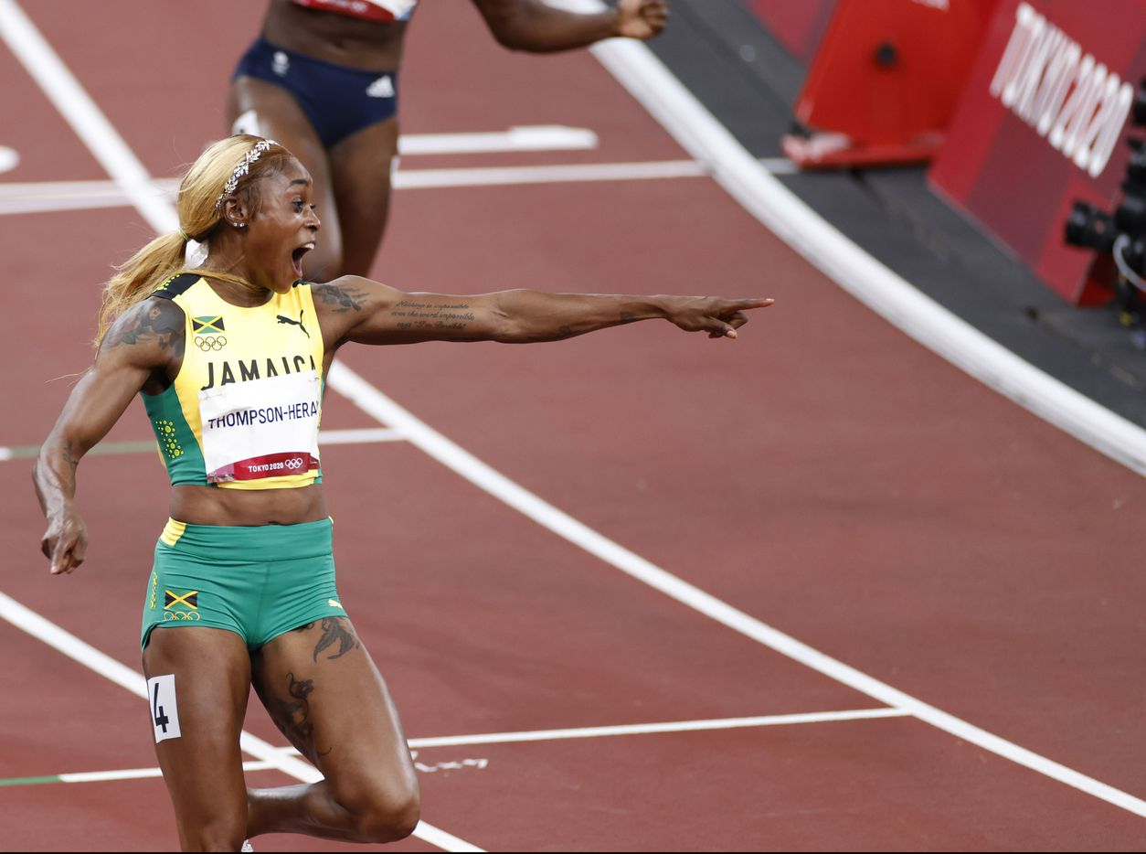 Jamaica's Elaine Thompson-Herah celebrates as she comes across the finish line winning the women's 100 meter final race during the postponed 2020 Tokyo Olympics at Olympic Stadium, on Saturday, July 31, 2021, in Tokyo, Japan. Thompson Herah broke the Olympic record with a time of 10.61 to earn a gold medal. (Vernon Bryant/The Dallas Morning News)
