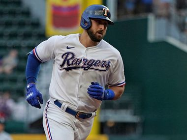 Texas Rangers center fielder Joey Gallo (13) rounds the bases after hitting a home run against the Seattle Mariners in the second inning of a baseball game Saturday, May 8, 2021, in Arlington, Texas. (AP Photo/Louis DeLuca)
