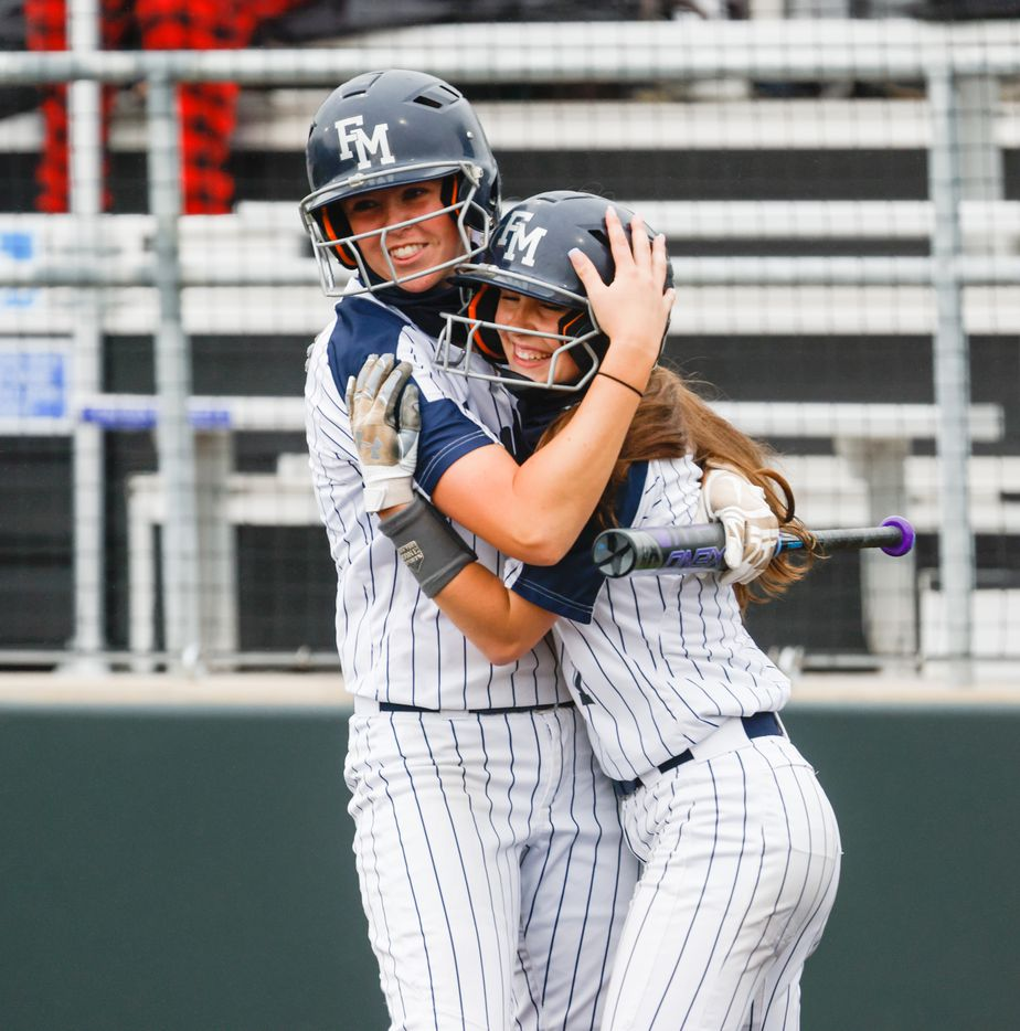 Flower Mound's Logan Halleman (7) celebrates with teammate Jordyn Holland (18) after hitting a home run against McKinney Boyd during the first inning of a Class 6A bi-district playoff game on Friday, April 30, 2021, in Denton. (Juan Figueroa/The Dallas Morning News)