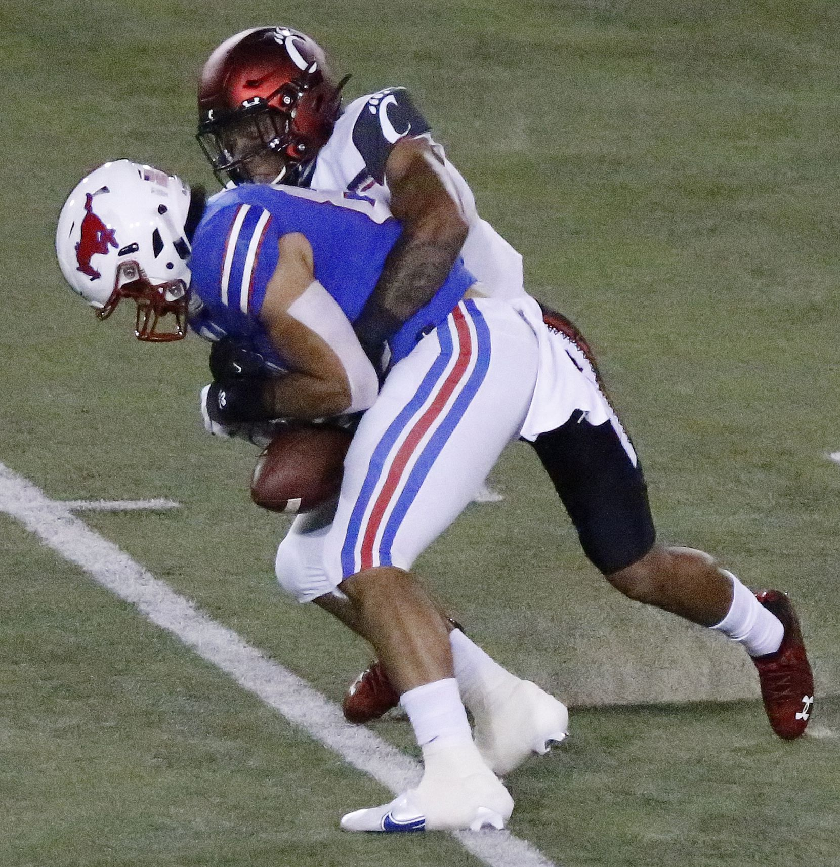 Southern Methodist Mustangs tight end Kylen Granson (83) was unable to hang onto this pass as he was defended by Cincinnati Bearcats safety Darrick Forrest (5) during the first half as SMU hosted Cincinati University in an AAC football game at Ford Stadium in Dallas on Saturday night, October 24, 2020. (Stewart F. House/Special Contributor)