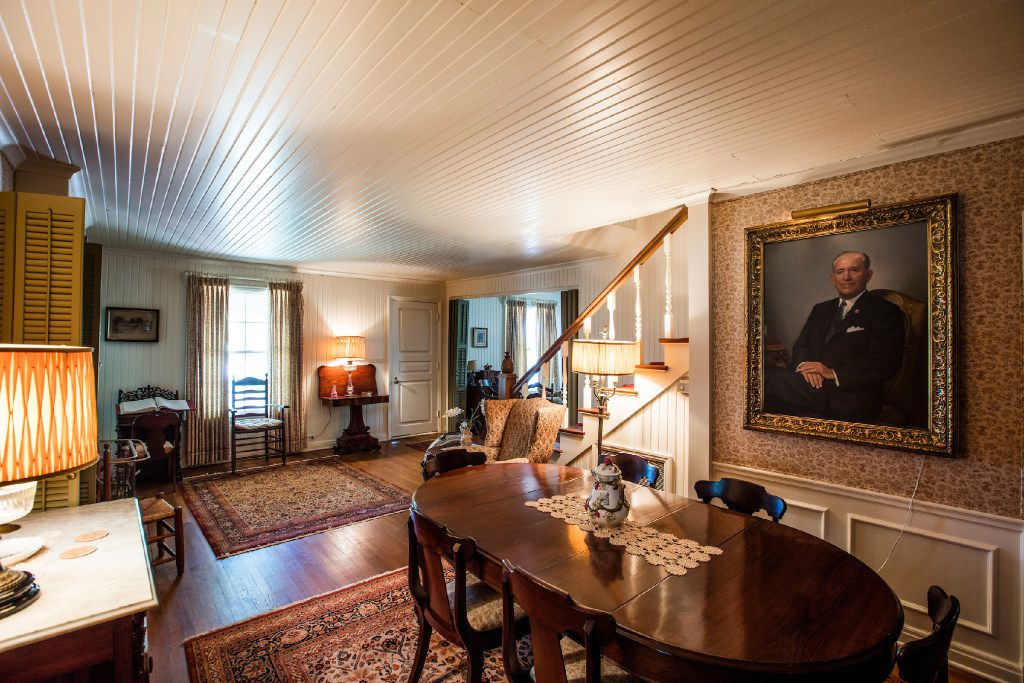 From his portrait, Toddie Lee Wynne looks over the dining table at the Big House on his family's Star Brand Ranch in Kaufman County.