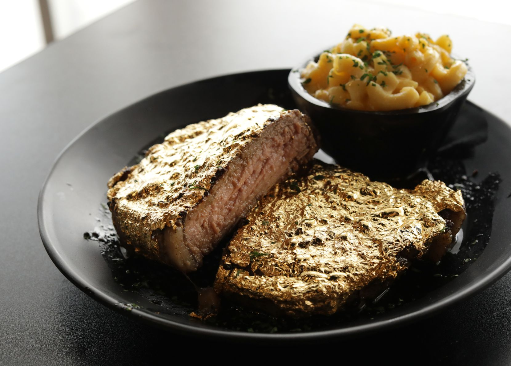The Saint's 24ct gold steak photographed at the new Bells Sweet Factory in Plano, TX, on Oct. 1, 2021.  (Jason Janik/Special Contributor)