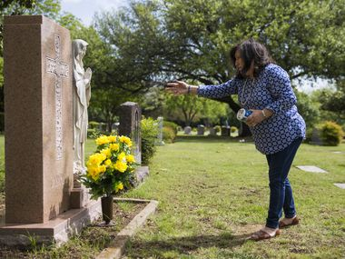"""Mary Frances Archer tossed blessed salt on the final resting place of her father, Frank Campise, at Calvary Hill Cemetery in Dallas on April 18. """"I won't say that the virus took him away, because that isn't what killed him,"""" Archer says. """"But it is a part of what killed him."""""""