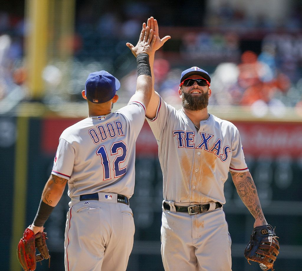 HOUSTON, TX - MAY 04: Rougned Odor #12 of the Texas Rangers and Mike Napoli #5 high five after a defensive stop against the Houston Astros at Minute Maid Park on May 4, 2017 in Houston, Texas. (Photo by Bob Levey/Getty Images)