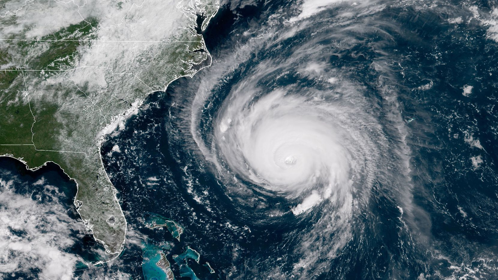 In this satellite image, Hurricane Florence churned through the Atlantic Ocean toward the East Coast on Wednesday and was forecast to turn south, stalling along North and South Carolina. It was expected to bring  torrential rain, high winds and a dangerous storm surge.