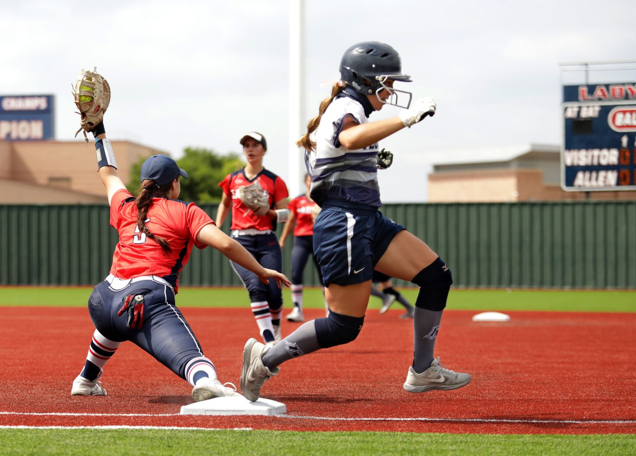 Allen High School player #5, Brooklyn Purtell, takes out Flower Mound High School player #10, Jori Whinery, during a softball game at Allen High School in Allen, TX, on May 15, 2021. (Jason Janik/Special Contributor)
