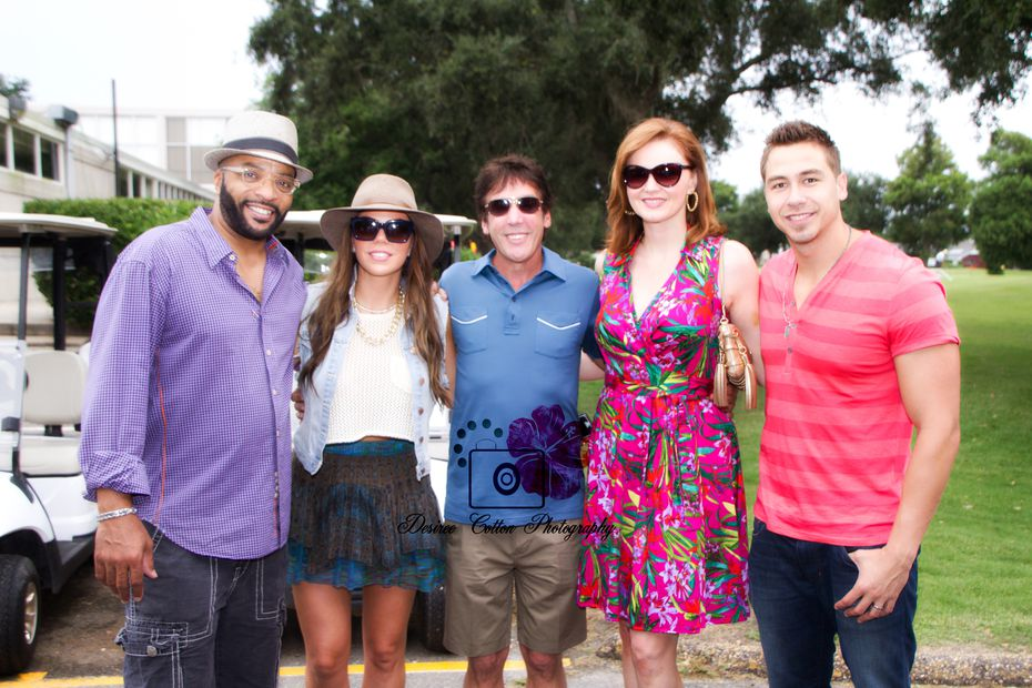 "Kidd Kraddick (center) poses for his last photo with the cast of 'Kidd Kraddick Morning Show' shortly before he collapsed and died at a golf tournament in Louisiana in 2013. Alaric ""Big Al"" Mack, Jenna Owens, Kellie Rasberry and Jose ""J-Si"" Chavez have continued the show."