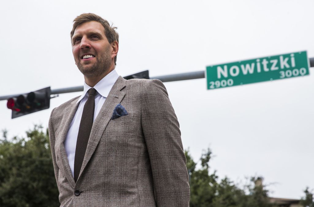 Retired Dallas Mavericks player Dirk Nowitzki poses for photos after unveiling a street sign with his name on Wednesday, October 30, 2019 outside American Airlines Center in Dallas. (Ashley Landis/The Dallas Morning News)