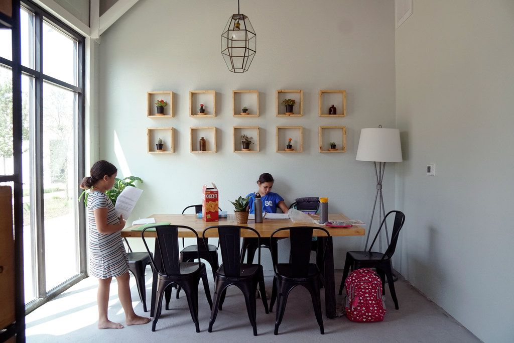 Jane, 8, and Maddy Howard, 12, work on their homework at Leaves Book and Tea Shop in Fort Worth. The shop not only sells tea and books, it's kid friendly.