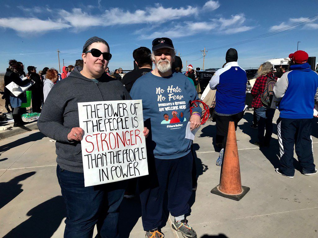 April Dawkins, 42, and her father Spencer Dawkins, 64, drove 10 hours from Dallas to sing Christmas carols and protest the detention of youths at the tent city in Tornillo on Dec. 23, 2018.