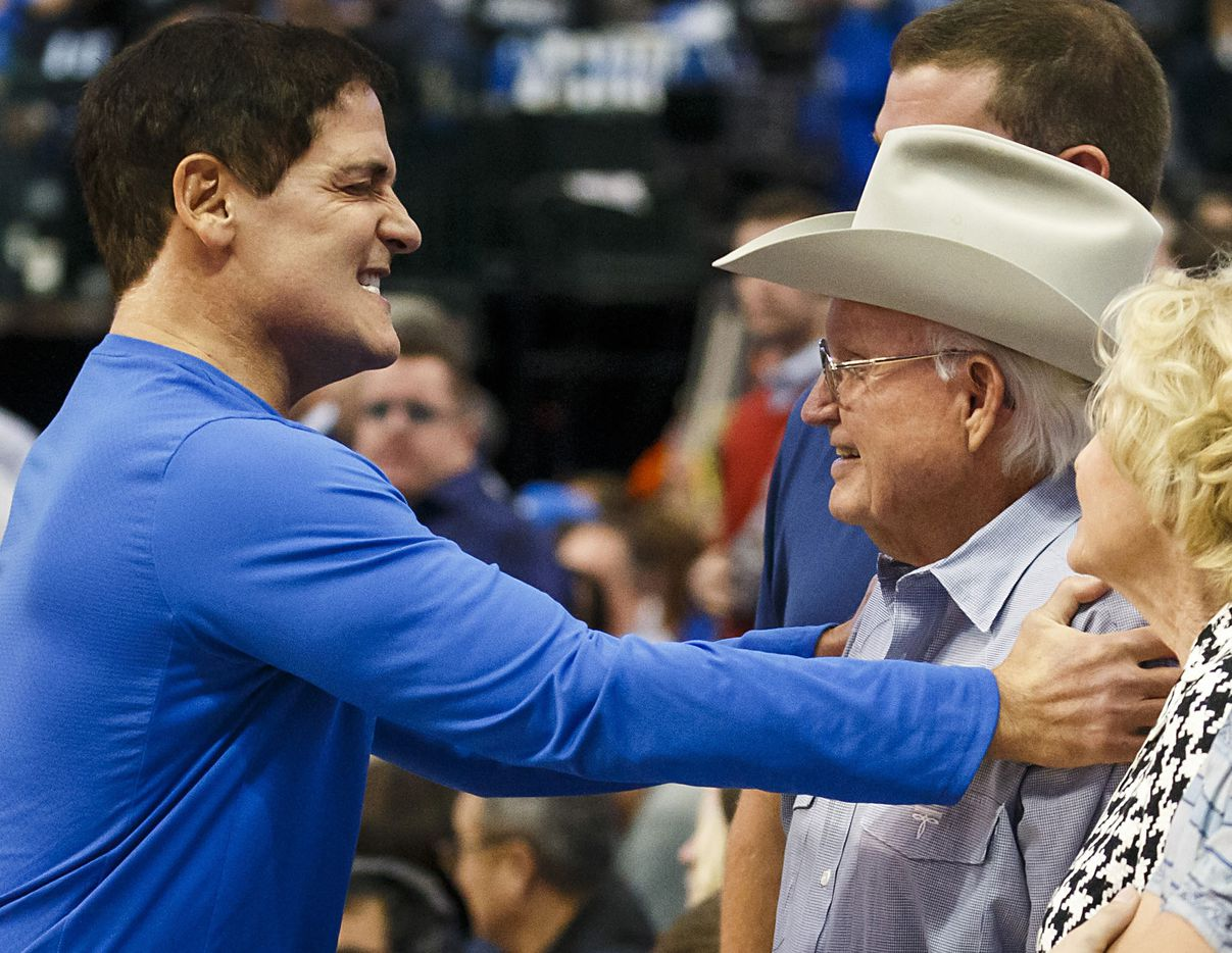 Dallas Mavericks owner Mark Cuban (left) hugs former team owner Don Carter  before an NBA basketball game against the Atlanta Hawks at American Airlines Center on Wednesday, Oct. 18, 2017, in Dallas.