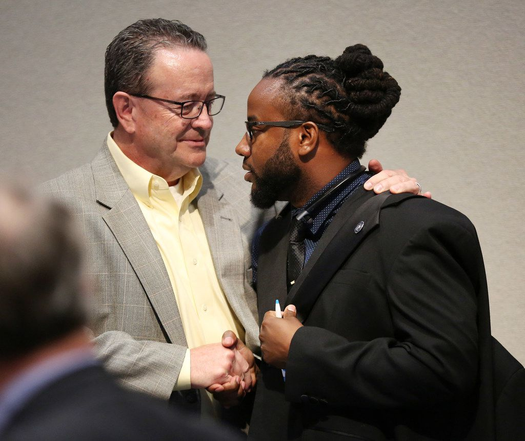McKinney city councilman Scott Elliott (left) greets La'Shadion Shemwell after a special meeting of the McKinney City Council at City Hall in McKinney.