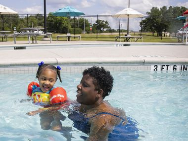 Dawn Matthews of Huntsville, Ala., swims with great-niece Leilani Wyatt, 4, of Garland at the Cove Aquatic Center at Crawford, a Dallas water park, on Saturday, May 29, 2021. Leilani had to stop taking swimming lessons at the bringing of the COVID-19 pandemic and is re-learning how to swim.
