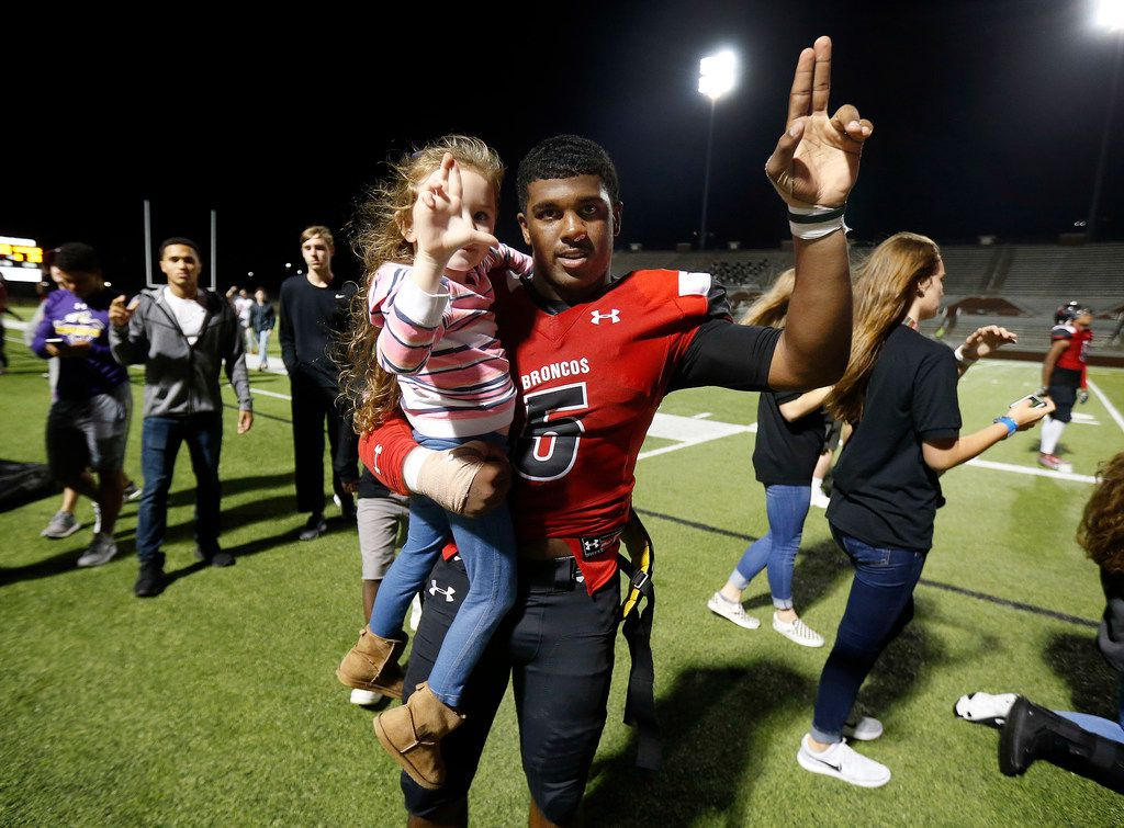 Mansfield Legacy quarterback Jalen Catalon (5) sings the school sing following their win over Waxahachie at Vernon Newsom Stadium in Mansfield, Texas, Friday, October 20, 2017. Legacy won, 39-34.(Tom Fox/The Dallas Morning News)