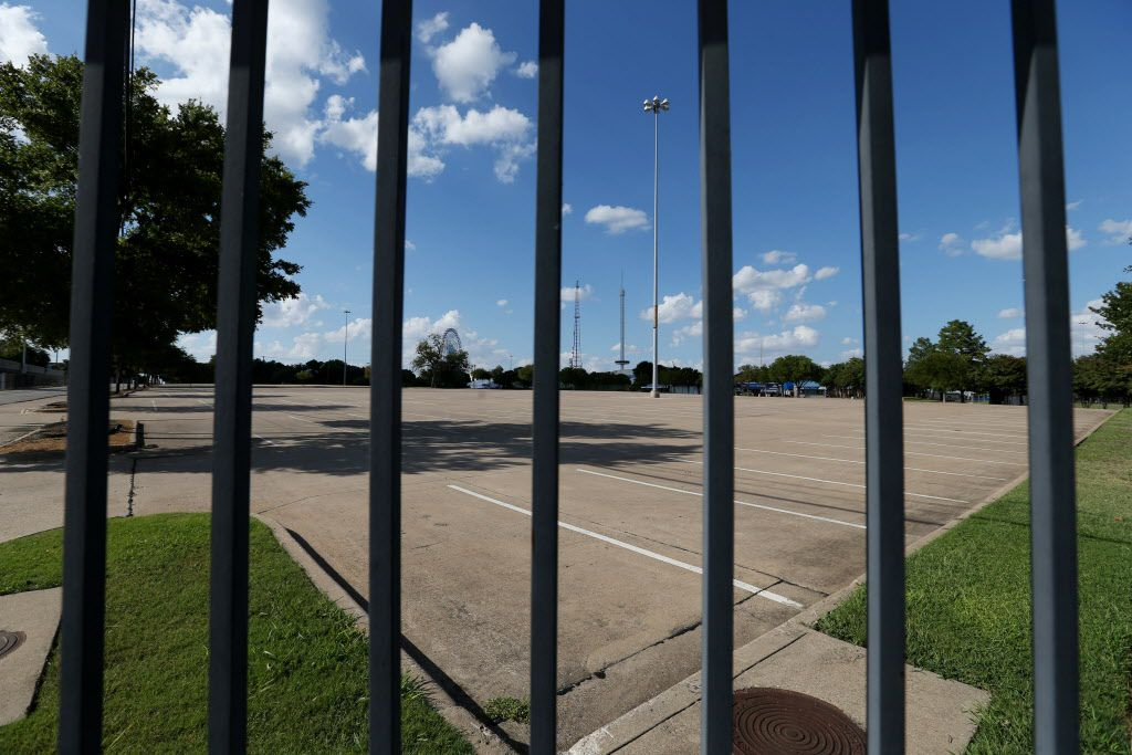 A parking lot on the southeast end of Fair Park near the corner of Robert B Cullum Boulveard and South Fitzhugh Avenue underscores the vast amount of park space devoted to asphalt. This also used to be a neighborhood, until the city and the State Fair seized and destroyed homes.