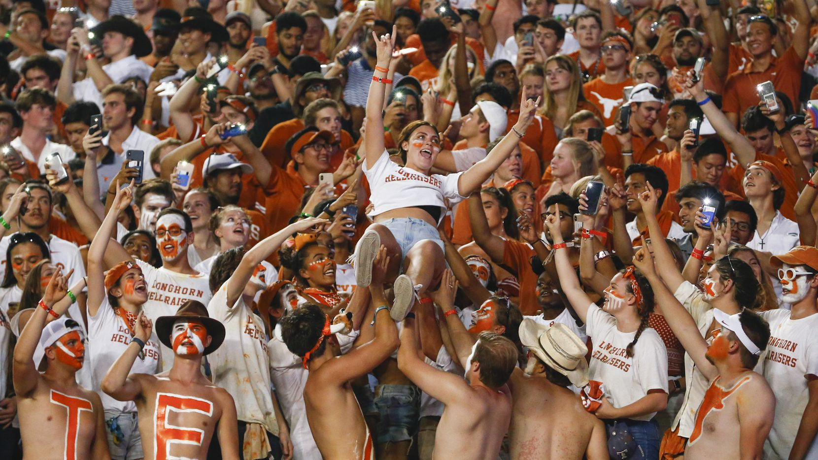 A student fan is lifted into the air during the third quarter of a college football game between the University of Texas and Louisiana State University on Saturday, Sept. 7, 2019 at Darrell Royal Memorial Stadium in Austin, Texas. (Ryan Michalesko/The Dallas Morning News)