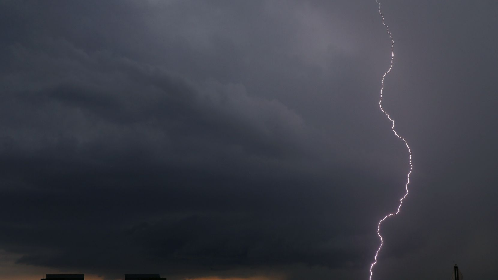 A lightning bolt from a thunderstorm strikes down in Irving, Texas, Thursday, June 7, 2018.