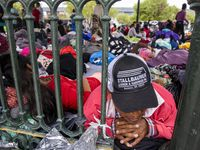 "Laureano Sanchez, a migrant from Guatemala, lays among dozens of other expelled migrants resting in a gazebo in a public square in the Mexican border city of Reynosa on Wednesday, March 31, 2021. He traveled to the U.S. with his teenage daughter only to be expelled back to Reynosa. ""It's so difficult,"" Sanchez said of being stranded in Reynosa. ""But we know nothing is difficult for God, and there's nothing that's impossible for him."""