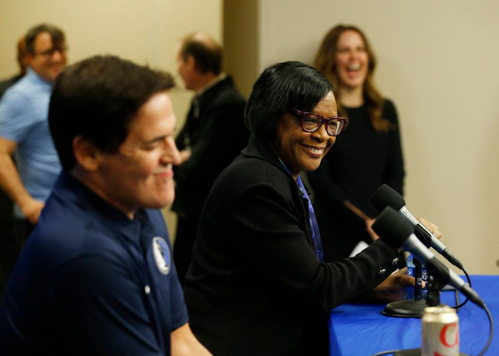 Dallas Mavericks CEO Cynthia Marshall answers questions from the media as owner Mark Cuban listens during the February news conference at American Airlines Center to announce her hiring.