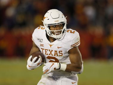 Texas running back Roschon Johnson carries the ball up field during the second half of an NCAA college football game against Iowa State, Saturday, Nov. 16, 2019, in Ames, Iowa. Iowa State won 23-21. (AP Photo/Charlie Neibergall)