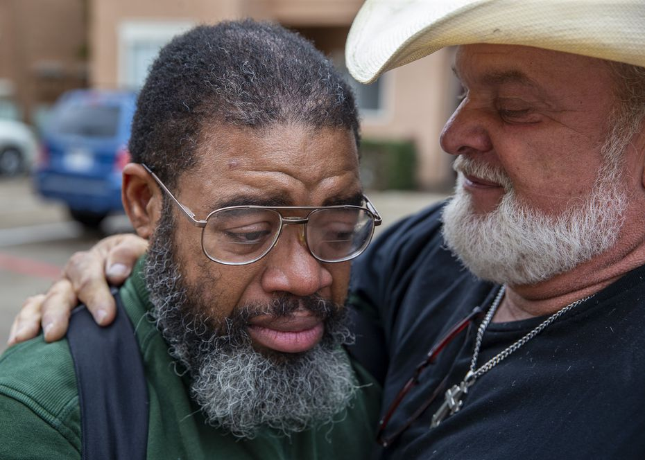 """S.O.U.L. Church pastor Leon Birdd (right) embraced Randy after surprising him at his new Cityplace apartment on Jan. 14, 2020, with a moving truck filled with donated furniture and belongings. """"It was a real treat to see them,"""" Randy said, adding that he'd found a spiritual family at S.O.U.L. Church. """"Blood is thicker than water, but the Spirit will override everything."""""""