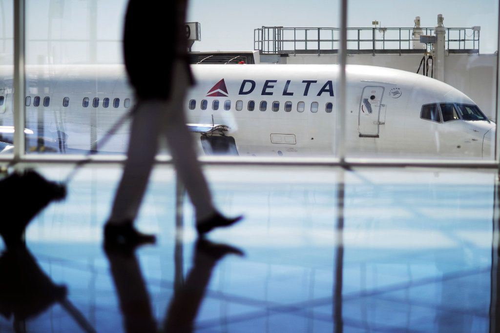 FILE - In this Oct. 13, 2016 file photo, a Delta Air Lines jet sits at a gate at Hartsfield-Jackson Atlanta International Airport in Atlanta.  Delta Air Lines says it has canceled about 3,000 flights this week as it continues to struggle in the aftermath of a storm that hit its hub airport in Atlanta. The thunder storm hit Wednesday, April 5, 2017, but canceled flights and long lines in Atlanta persisted into Friday. Tracking service FlightAware.com says Delta had canceled more than 400 flights by midday.  (AP Photo/David Goldman)