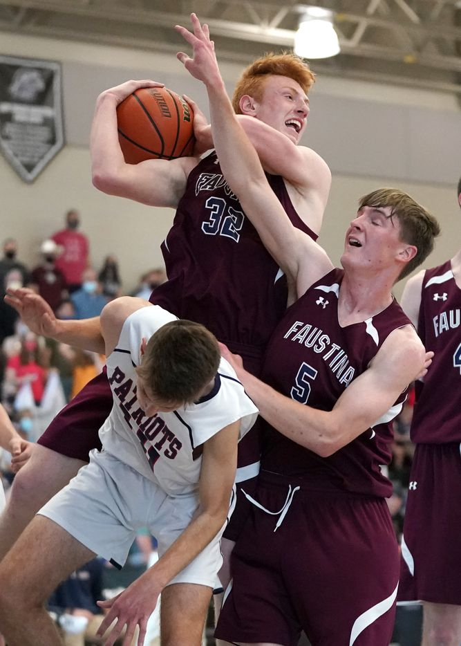 Irving Faustina's Will Atto (32) and teammate Robert Cook (5) go for a rebound over Cypress Covenan's Ezra Seay (10) during the TAPPS 1A boys basketball championship game at College Station High School in College Station, Texas on Saturday, March 13, 2021. (Sam Craft/Special Contributor)