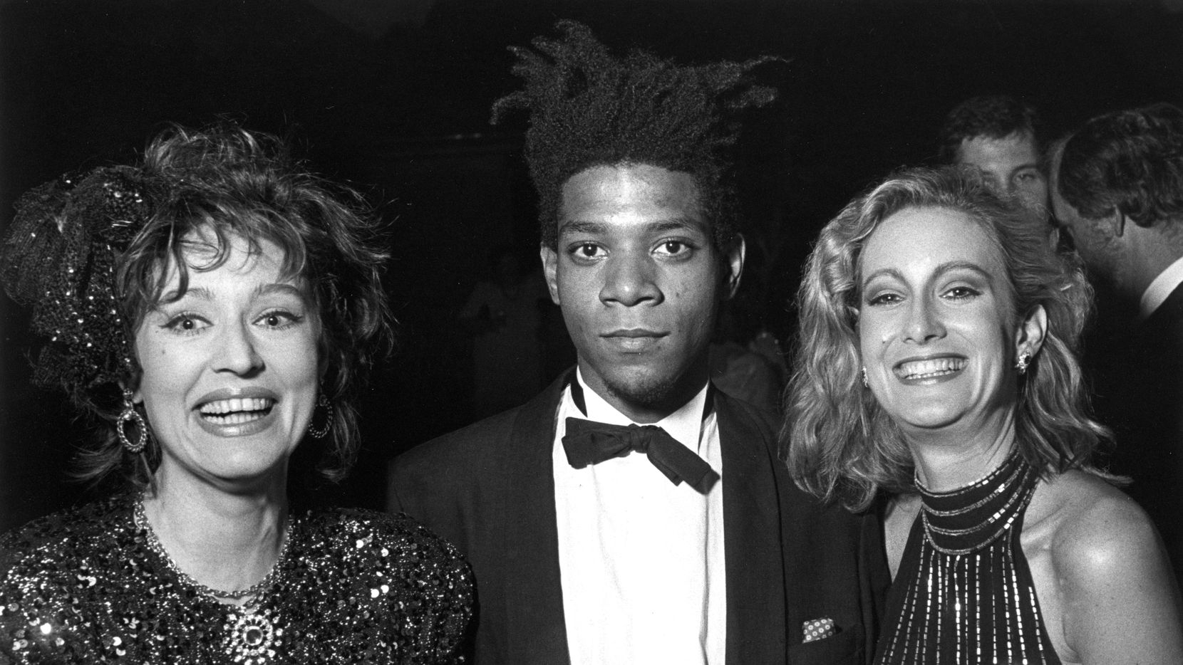 """Jean-Michel Basquiat appears at the opening of the Dallas Museum of Art's """"Primitivism in 20th Century Art"""" show in 1985."""