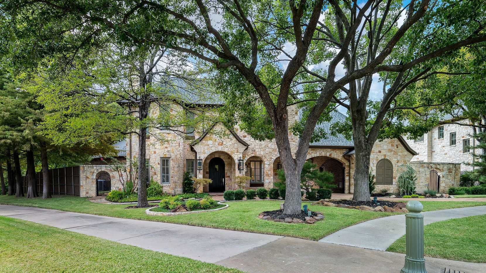The newly updated estate at 6644 Whispering Woods Court in Plano is offered at $1,599,900.