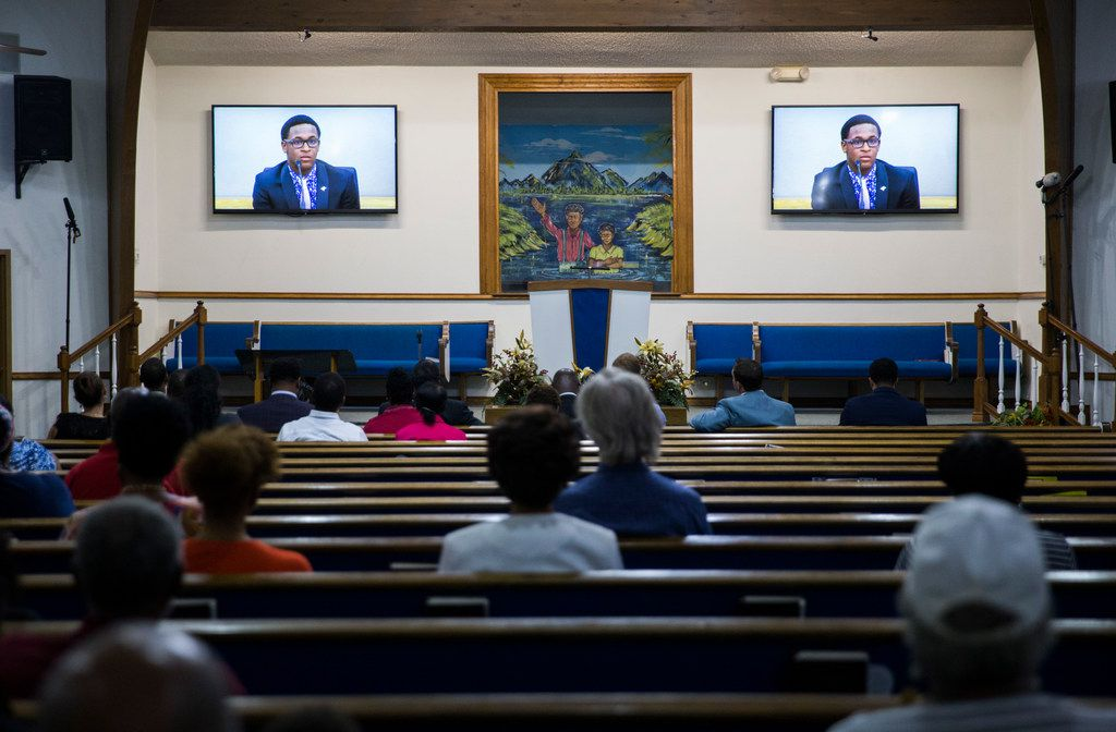 A video of Brandt Jean, Botham Jean's brother, plays at a church service where Bertrum Jean and Allison Jean, parents of Botham Jean, spoke Wednesday after Amber Guyger's sentencing.