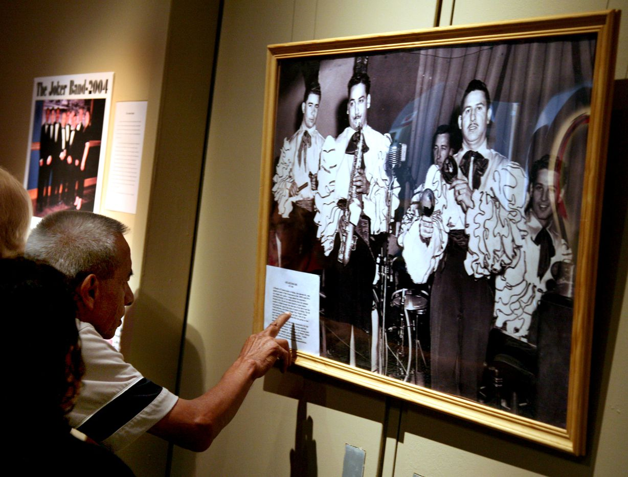 Louis Martinez reads about Joe Azcona Sr., a pioneer of Tropical music in Dallas. Azcona was known as leader of Son Tropicanos in the 1940's and 50's. Martinez and his wife, Carmen Martinez of Fort Worth visited the exhibit, Los Barrios: Impact of Mexican-American Barrios in Dallas, 1907-2007.