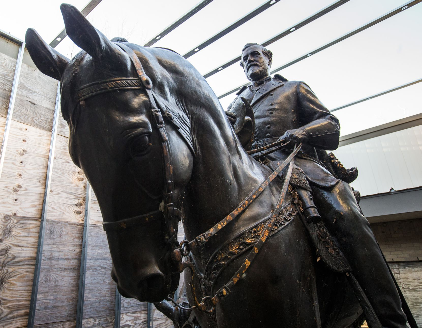Few people have seen what became of Alexander Phimister Proctor's statue of Robert E. Lee (left) and a young soldier since its removal from the park formerly known as Lee Park,  where it stood for over 80 years until it's removal in Sept. 2017. Shortly before Christmas, on Dec. 20, 2018, The Dallas Morning News got a behind-the-scenes look the secure storage area where the statue of the Confederate general is being kept in an enclosure of plywood and metal studs, at Hensley Field, the former Naval Air Station on the west side of Mountain Creek Lake in Dallas.