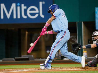 Texas Rangers third baseman Isiah Kiner-Falefa (9) hits the ball pitched by Seattle Mariner at Globe Life Field on Sunday, May 9, 2021, in Arlington.