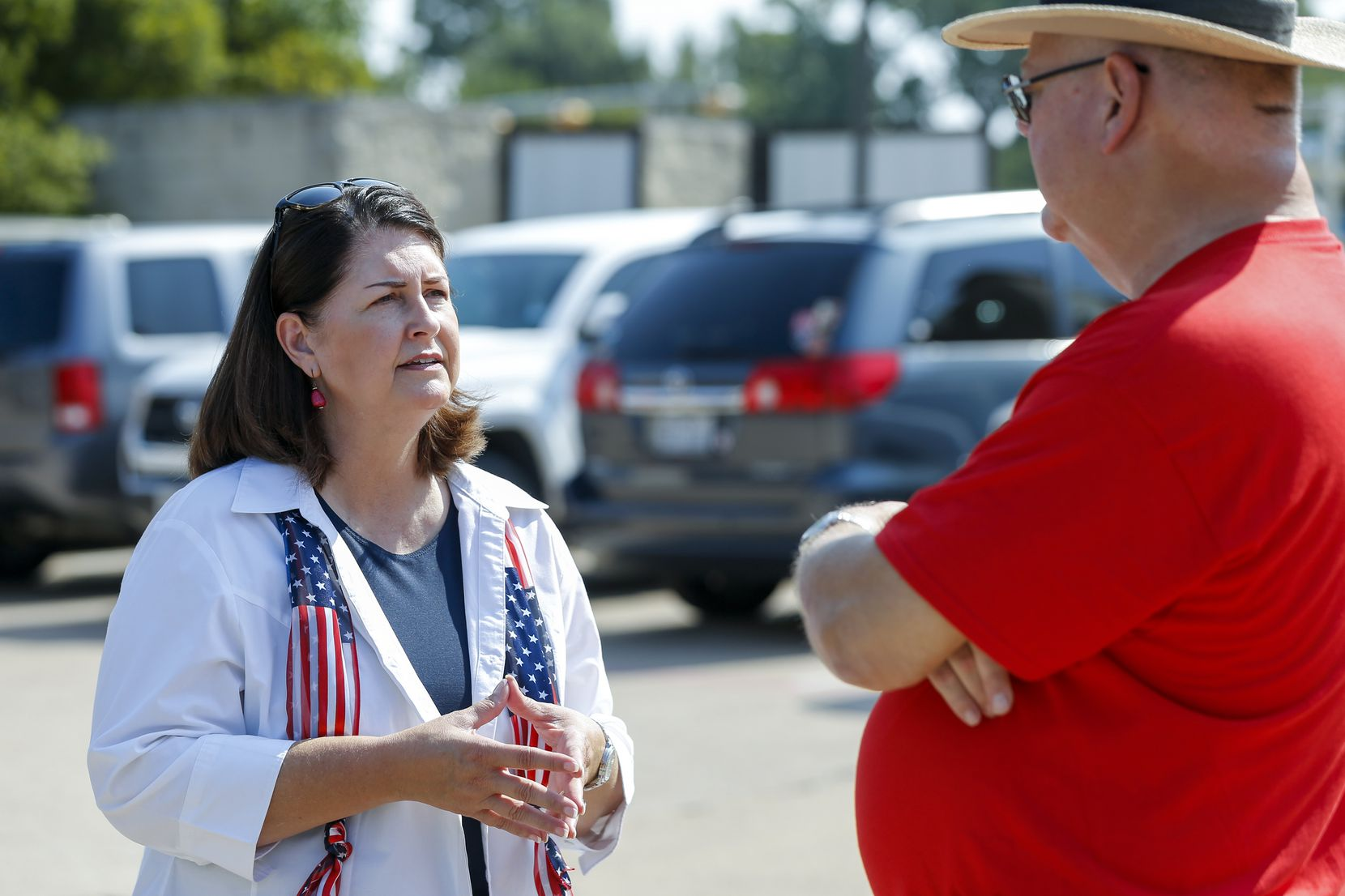 Susan Wright, Republican candidate for Texas' 6th Congressional District (left), speaks with Linton Davis of Arlington outside a polling location during early voting for a special runoff election on Thursday, July 22, 2021, in Arlington. (Elias Valverde II/The Dallas Morning News)